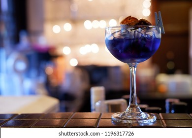 purple daiquiri cocktail at night party