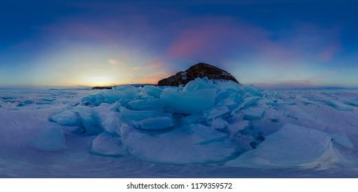 Purple dawn of ice hummocks on Lake Baikal on the island of Olkhon. Spherical 360 vr degree panoramic view