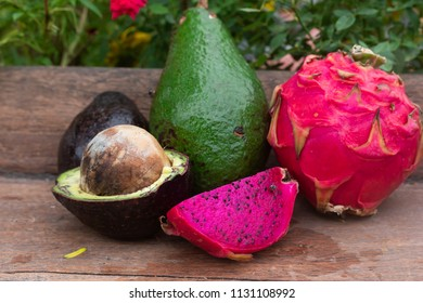 purple dragon fruit and avocado fruit on table background