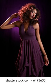 purple dress with elbow to left