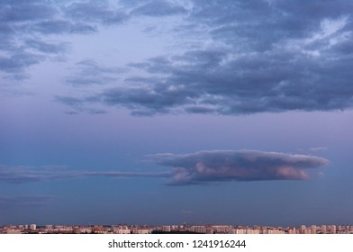 Purple evening sky over the big city. Sunset and beautiful clouds