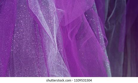 Purple fabric with light texture