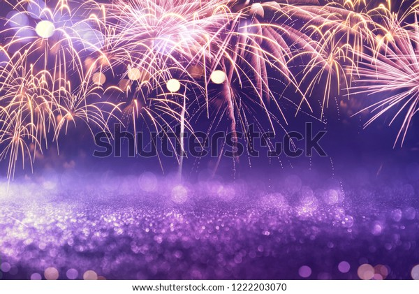 Purple fireworks and bokeh in New Year eve and copy space. Abstract background holiday.
