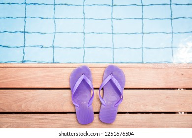 Purple Flip Flops By The Pool