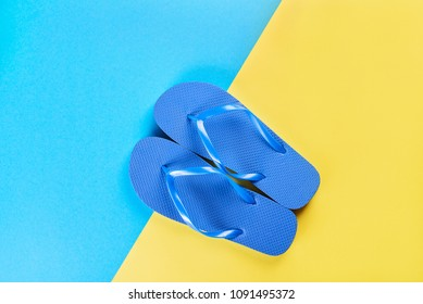 purple flip flops on a yellow-blue background