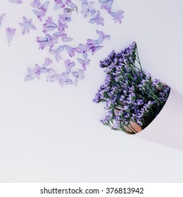 Purple Flowers on white background. Aroma of Spring. Minimalism style