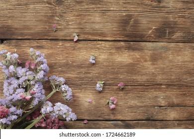 purple flowers on wooden background