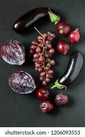 purple foods on a black background
