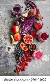 Purple fruit and veggies background with superfoods bowl. overhead on stone surface with natural light. New trend colorful rustic collage