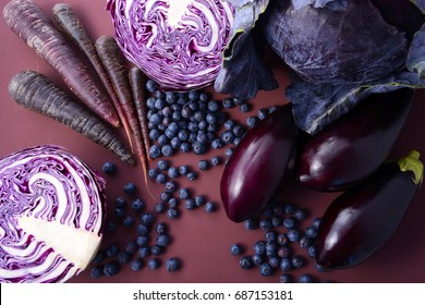 Purple fruits and vegetables thay contain Anthocynins, found in the Okinawan diet, that maintain healthy blood vessels and promote longevity, with spotlight lighting.