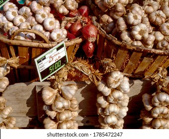 Purple garlic for sale at a farmers market in France, Europe