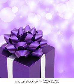 Purple gift box with gift ribbon isolated on purple background : purple gift boxes - princetonregatta.org