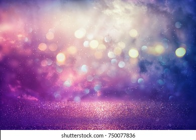 Purple glitter lights background. defocused