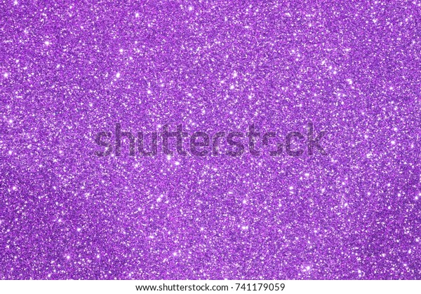 purple glittering background with reflections and more lights