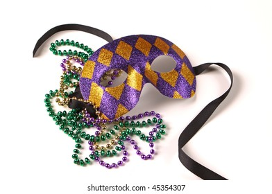 Purple and gold Venetian Mask with green, gold, and purple Mardi Gras beads