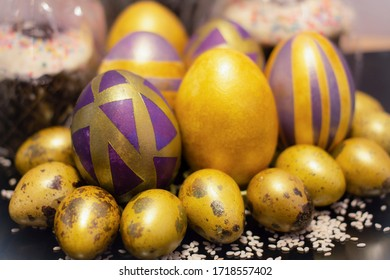 Purple golden Easter eggs with pattern on a black background