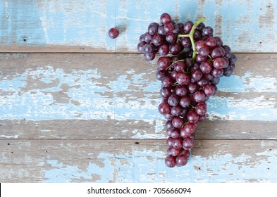 purple grapes  on wood background.