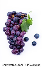 purple grapes with water drops on white background