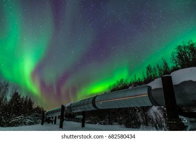 Purple and green Northern Lights over Alaska Pipeline