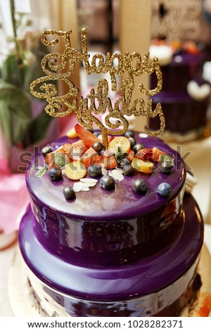 Purple Happy Birthday Cake With Golden Letters Dozen Of Violet Cakes Gold And Fruits