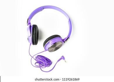 Purple headphones isolated on white background