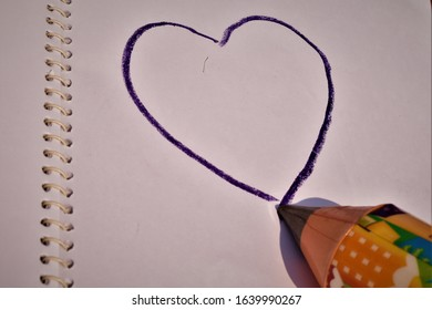 purple heart drawing with pencil pointed on artistic paper