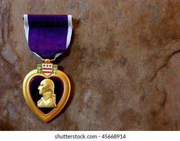 A Purple Heart Military Decoration Against a Slate Background