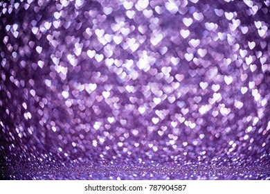 Purple Hearts Background with Bright Bokeh Lights
