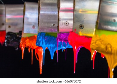 purple ink drop down from print handle.Plastisol ink for print tee shirt is oil based.after printed the ink will stick on tee shirt for long time. in factory they hang on the print handle in the air
