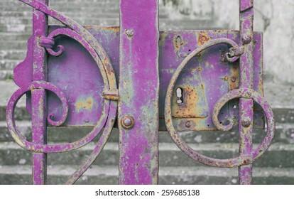Purple iron gate closed