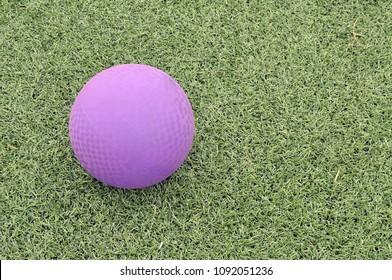 A Purple Kickball on Green Artificial Turf