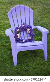 Purple lawn chair with lavender and fairy rose wreath/Lavender flowered wreath in purple chair