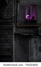Purple light in the window of residential building