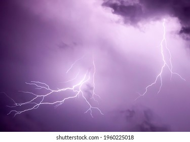 Purple Lightning. Electrical storm illuminates clouds in the sky with a purple hue.