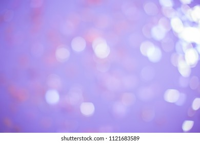 Purple lights with blur. It looks like a holiday with serpentine, glow and brilliance.
