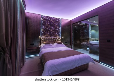 Purple lights in luxury bedroom interior
