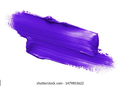 Purple lipstick or paint smear smudge swatch isolated on white background. Cream makeup texture. Colored cosmetic product brush stroke swipe sample