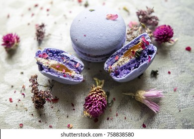 Purple macarons with wildflowers