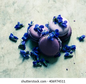 Purple macaroons and  flowers/toned photo