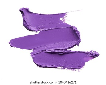 Purple makeup smear of lip gloss isolated on white background. Purple lipstick texture isolated on white background. Broken purple lipstick