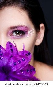 Purple make-up with stars and a purple flower