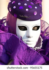 purple mask on the carnival in Venice