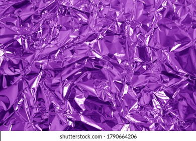 Purple metallic foil shiny texture, wrinkled wrapping paper for background and design art work.