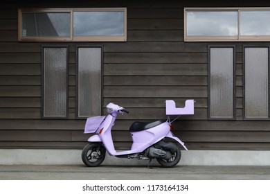 purple motercycle  wooden house background