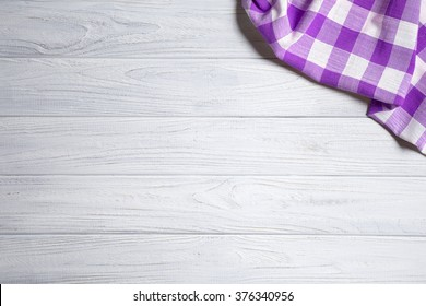 Purple napkin on the old wooden table.