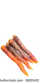 Purple orange carrot variety over white background