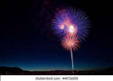 Purple and Orange Fireworks Bursts for a July 4th Celebration