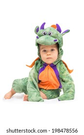 Purple, orange and green dragon costume on baby isolated on pure white