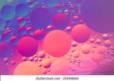 Purple, orange, red and blue psychedelic oil and water abstract, unfocused