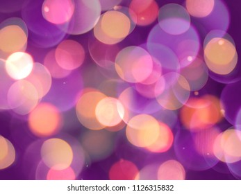 purple and orange round blurred lights abstract with sparkles on a back background